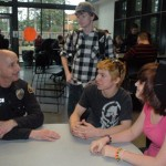 From left, Marysville Police School Resource Officer Dave White takes a moment during lunch at Marysville Getchell High School to chat with students Dalton Adcock, Curtis Combs and Bionca Perez. Photo: Kirk Boxleitner.