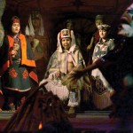 American Indian dancers perform during dinner in the longhouse at Tillicum