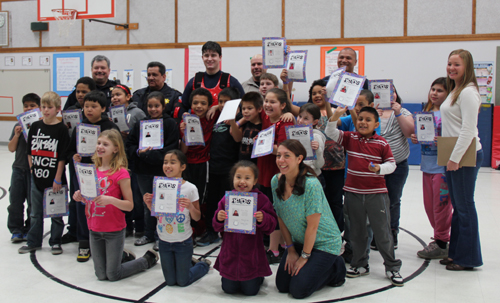 Students, instructors and Tulalip police officers celebrate the 21 radKIDS graduates.