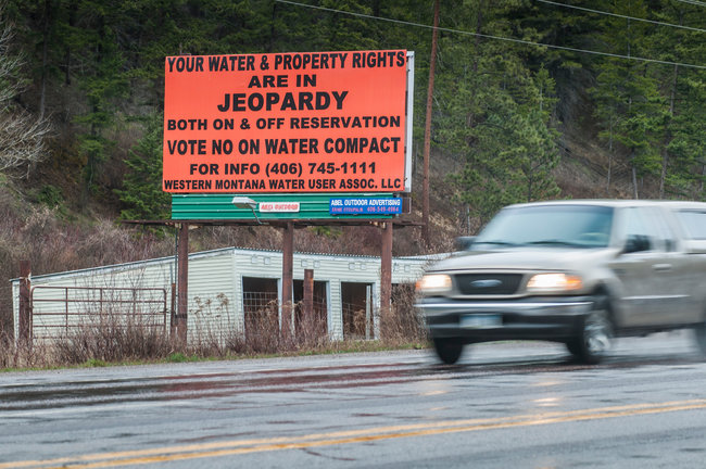 Tony Demin for The New York TimesA billboard at an entrance to the Flathead Reservation in western Montana, where a bitter dispute has divided the residents.