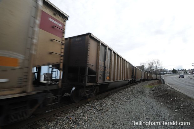 A coal train heads through downtown Bellingham alongside Roeder Avenue Wednesday, Feb. 27, 2013.PHILIP A. DWYER — THE BELLINGHAM HERALD