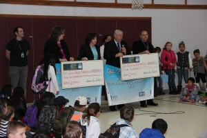 Members of the NEA and WEA present banners and library checks at Tulalip Quil Ceda Elementary.