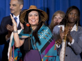 Deborah Parker, vice chair of the Tulalip Tribes of Washington state, reacts to President Barack Obama signing the Violence Against Women Act in 2013 in Washington. Manuel Balce Ceneta/AP