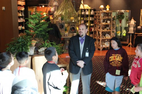 TRC General Manager Sam Askew greets the children on their field trip and explains a little but about the art featured at the resort.