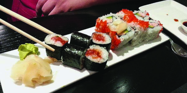 Tribal employee, Andrew Gobin enjoys a Spicy Tuna roll and a California roll at the new Tulalip Resort Casino restaurant, Journey's East. Photo/Monica Brown