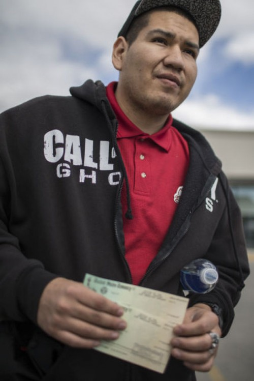 James C'Hair shows settlement checks from the Office of the Special Trustee for American Indians received by him and his wife Wednesday outside Atlantic City Federal Credit Union in Riverton.Ryan Dorgan | Star-Tribune