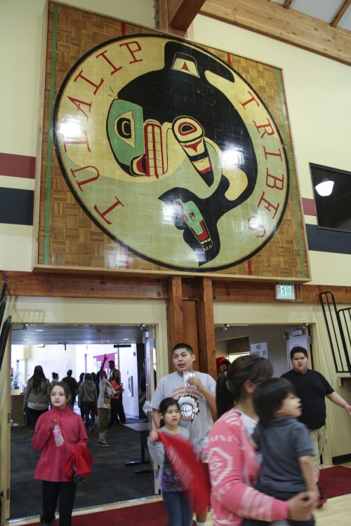 Above the new basketball court in the Don Hatch Youth Center gym hangs the former basketball middle court emblem which previously used to be where the new youth center sits. Photo/ Brandi N. Montreuil, Tulalip News