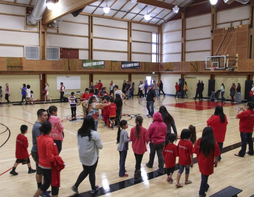 The new Don Hatch Youth Center's gym still displays on the walls cutouts of the former basketball court flooring that new center's basketball court replaced. Photo/ Brandi N. Montreuil, Tulalip News