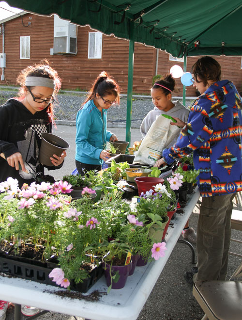Tulalip tribal member Mandy Carter volunteered her gardening expertise to teach the girls how to plant their own vegetables and flowers during the Girls Group opening house held on April 10. Photo/ Brandi N. Montreuil, Tulalip News