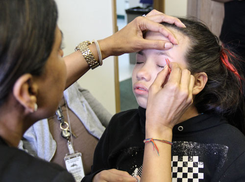 A health and beauty station was available during the Girls Group open house on April 10, where girls received hand massages, aromatherapy, and facial beautification.Photo/ Brandi N. Montreuil, Tulalip News