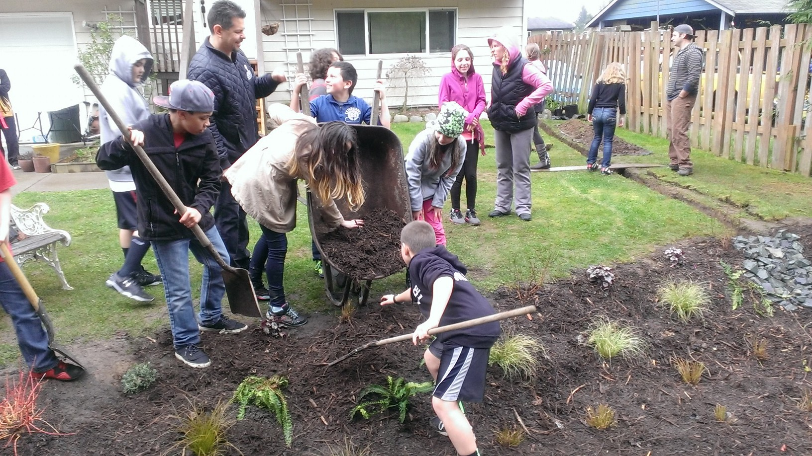 Marshall Elementary students were invited to come help plant in the new rain garden. Photo by Valerie Streeter