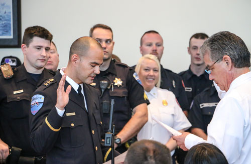 Tulalip Police Department's new Chief of Police, Carlos Echevarria, takes his oath in front of Tulalip Tribes vice-chairman Les Parks and local law enforcement and service agencies on May 7.  Photo/ Brandi N. Montreuil, Tulalip News