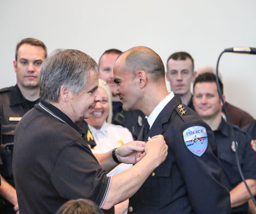 Former Tulalip Police Chief, Jay Goss, pins newly appointed Police Chief Carlos Echevarria during the swearing in ceremony held May 7, in the Tulalip Tribes Board Room. Photo/ Brandi N. Montreuil, Tulalip News