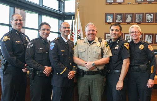 Tulalip Police Chief Carlos Echevarria is joined by (left to right) Marysville Police Chief Rick Smith, Shoreline Police Chief Shawn Ledford, Snohomish County Sheriff Ty Trenary, Lake Stevens Interim Police Chief Dan Lorentzen, and Everett Police Chief Kathy Atwood. All who attended Chief Echevarria's swearing in ceremony on May 7. Photo/ Brandi N. Montreuil, Tulalip News