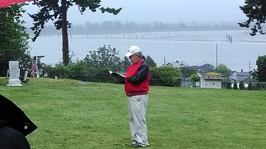Tulalip Veteran Cy Hatch Jr. calls the roll at Priest Point Cemetery. Photo: Andrew Gobin/Tulalip News
