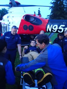 Tulalip Firefighter Nikolay Litvinchuk being loaded into a Med-Evac chopper  Photo: Andrew Gobin/Tulalip News