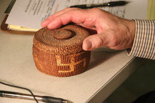 "A basket featuring the ""rolling logs"" pattern, which is sometimes confused with a swastika, was brought in by Bothell resident, Jim Freese to the May 3, Hibulb Appraisal Day. The unique weaving and emblem was considered good luck and used in the early 1900s. The basket was appraised at $125- $175. Photo/ Brandi N. Montreuil, Tulalip News"