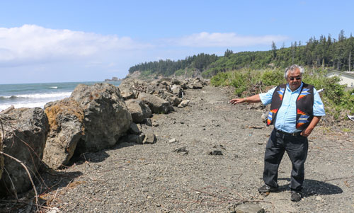 Quinault elder James DeLaCruz Sr. stands by the recently reinforced Taholah seaswall, is among the handful of residents who do not plan to leave the Lower Village during Taholah's relocation. Photo/ Brandi N. Montreuil, Tulalip News