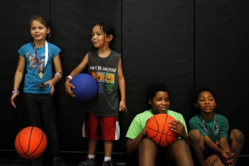 Ian Terry / the heraldFrom left, Georgetta Reeves, 8; Ladainian Kicking-Woman, 6; Tristan Holmes, 11; and Isaiah Holmes, 6, hang out together in the gym at the Tulalip Boys and Girls Club.