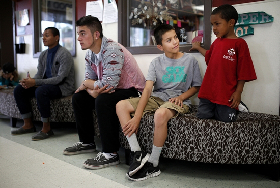 Ian Terry / The HeraldLeno Vela (center), 11, talks with JJ Gray (right), 5, at the Tulalip Boys and Girls Club.
