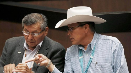 The Navajo Nation will receive $554 million from the U.S. to settle claims of mismanaged funds. Navajo Nation President Ben Shelly, left, talks with tribal presidential candidate Kenneth Maryboy this year. (Ross D. Franklin / Associated Press)