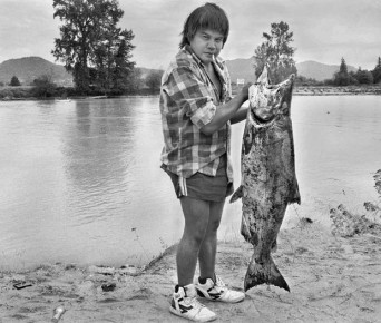 Scott Terrell photo  Tribal fisherman Randy Fornsby hoists a chinook salmon on the bank of the Skagit River west of Mount Vernon, Wash., Sept. 2, 1987. The Swinomish and Upper Skagit tribes shared a fishing area just upriver from where the Skagit breaks into its north and south forks.