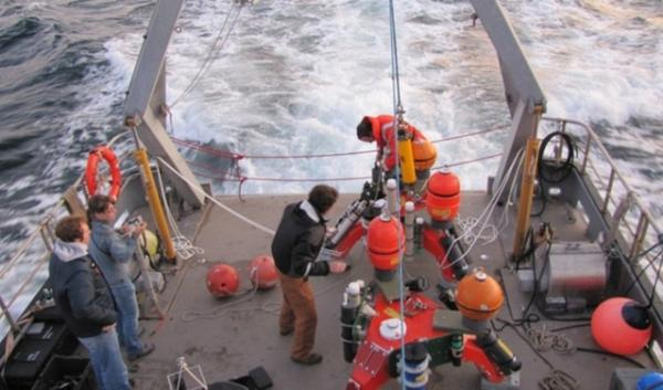 """A crew deploying a """"sea spider"""" in 2011 to collect data from the floor of Puget Sound in Admiralty Inlet. After eight years of testing and permitting processes, the Snohomish County PUD has decided to halt the project. 