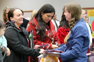 Tulalip Tribes council members Theresa Sheldon and Deborah Parker receive hand written notes from Stephanie Hope Smith from the Newtown Rotary Club, Monday, Nov. 3, 2014, at the Marysville School District Administrative offices. The notes were made by well wishers and given to the Sandy Hook Elementary School following the deaths of 26 children and adults from a 2012 shooting. (Tulalip News Photo/ Brandi N. Montreuil)