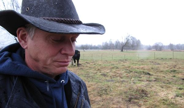 Richard Fox on his Skagit County property. On Tuesday a judge dismissed a lawsuit brought by Fox and his wife, Marnie, challenging a rule that prevents them from drilling a well. The rule is meant to provide water for spawning salmon during dry months.   credit: Ashley Ahearn / KUOW