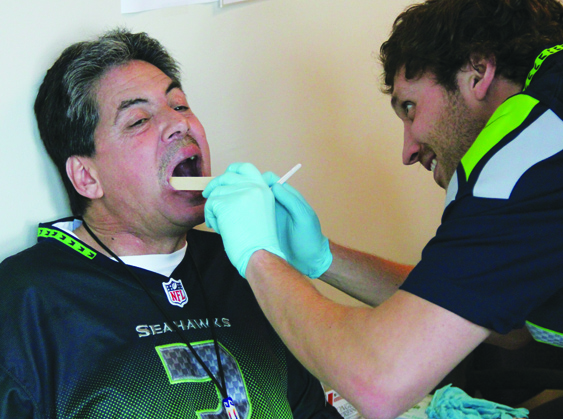 Tribal member Mike Murphy having an oral cancer screening performed.Photo/Micheal Rios