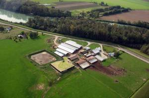 An aerial photo shows a manure lagoon at a dairy farm adjacent to the Nooksack River. Courtesy of Kim Koon.