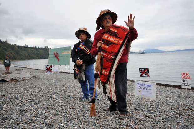 Then-Lummi Nation Chairman Clifford Cultee, left, and Hereditary Chief Bill James speak at a 2012 protest against a proposed coal export terminal at Cherry Point. The tribe sent a letter on Monday, Jan. 5, 2015 to the U.S. Army Corps of Engineers, asking the agency to reject a permit application for the coal terminal because it would interfere with tribal fishing grounds. PHILIP A. DWYER — THE BELLINGHAM HERALD