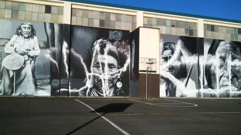 The Native-American murals at Wilson-Pacific, a Seattle Public Schools building, have been vandalized. (Andrew Morrison)