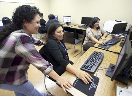 Melissa Verdin (from left), Clarice Friloux and Bette Billiot use computers Tuesday at the United Houma Nation Vocational Rehabilitation Program in Houma. Chris Heller/Staff
