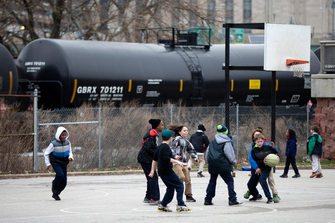 A train with oil tank cars idling in Philadelphia last month. The government has issued updated safety standards, which critics say do too little and the industry says are too strict.