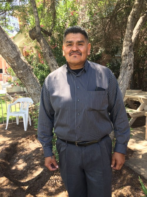 (Laurel Morales)Ken Lewis stands in front of Indian Rehab in Phoenix. He says he has been clean for eight years thanks to the people here and the traditional methods they offer.