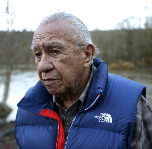 Billy Frank Jr. poses for a 2014 photo near Frank's Landing on the Nisqually River in Nisqually, Wash. Frank, a Nisqually tribal elder who was arrested dozens of times while trying to 'assert his native fishing rights during the Fish Wars of the 1960s and '70s. (AP Photo/Ted S. Warren, File)