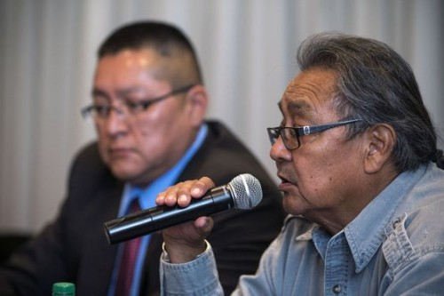 Leigh Kuwanwisiwma, right, director of the Hopi Tribe's Cultural Preservation Office, answers a question during a news conference on the Paris auctions selling Hopi sacred objects as Hopi Chief Ranger Ronald Honyumptewa looks on Wednesday, May 27, 2015 at the Heard Museum in Phoenix. Hopi tribal leaders and Arizona's members of Congress are asking U.S. law enforcement to stop the sale of about a dozen sacred Hopi artifacts at a Paris auction house in June. (Mark Henle/The Arizona Republic via AP) MARICOPA COUNTY OUT; MAGS OUT; NO SALES; MANDATORY CREDIT