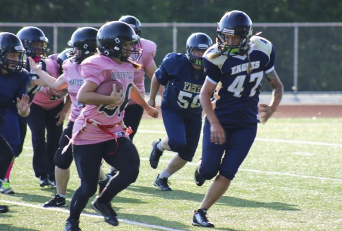 Tulalip tribal member Mytyl Hernandez known for her speed is in her second season with the Marysville Powderpuff Football Team. Photo/ Tulalip News, Brandi N. Montreuil