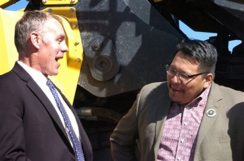 U.S. Rep. Ryan Zinke, left, laughs with Darrin Old Coyote, chairman of Montana's Crow Tribe, during Thursday's announcement in Billings of a proposal to make permanent a tax break for coal mined from reserves owned by American Indian tribes. Westmoreland Coal Company produced 6.5 million tons of coal last year from the Absaloka mine on the Crow's southeastern Montana reservation. Photo/ AP