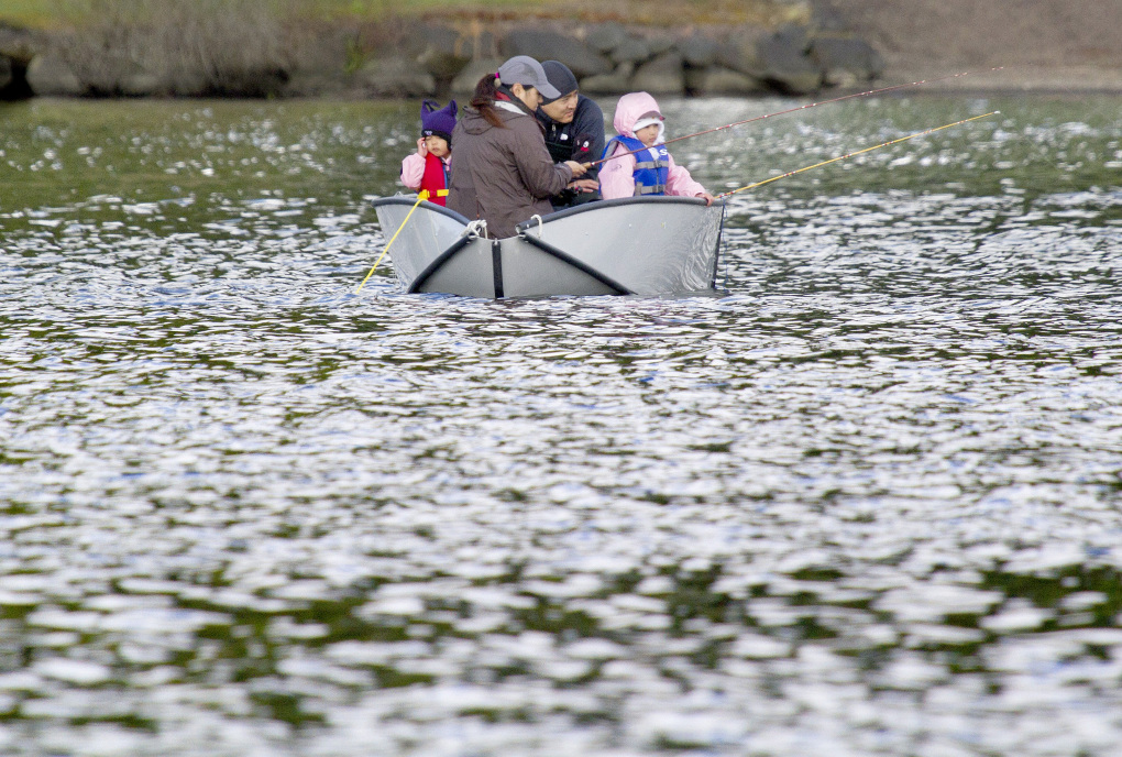 The Sugawara family from Mill Creek fish at Cottage Lake in Woodinville in 2014. (Mike Siegel/The Seattle Times)