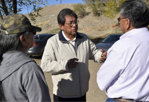 FILE - In this Nov. 2014, file photo, Navajo Nation presidential candidate Russell Begaye, center, speaks with a group during the Navajo Nation elections outside of the Shiprock Chapter House in Shiprock, N.M. Voters on the country's largest American Indian reservation are choosing a new president who will have to deal with rampant unemployment and a lack of infrastructure while helping tribal members through a bitter dispute that has divided communities. (Alexa Rogals/The Daily Times via AP, File)