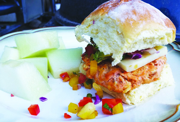 Salmon burger with fruit. Photo/Niki Cleay