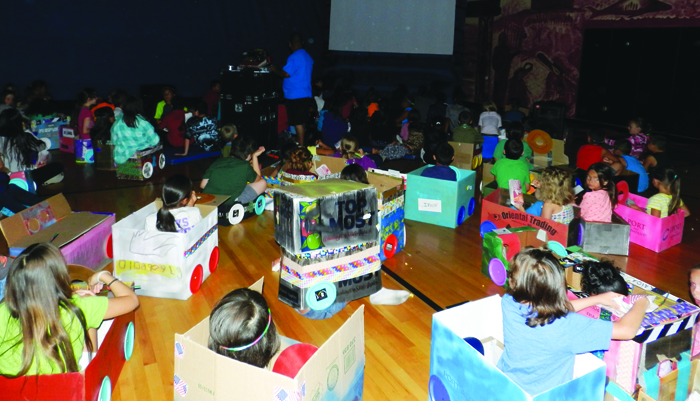 Drive-In Night. The kids worked all week to create their own make-shift cardboard cars so they could go to the drive-in and watch classic cartoons and movies.Photos/Micheal Rios