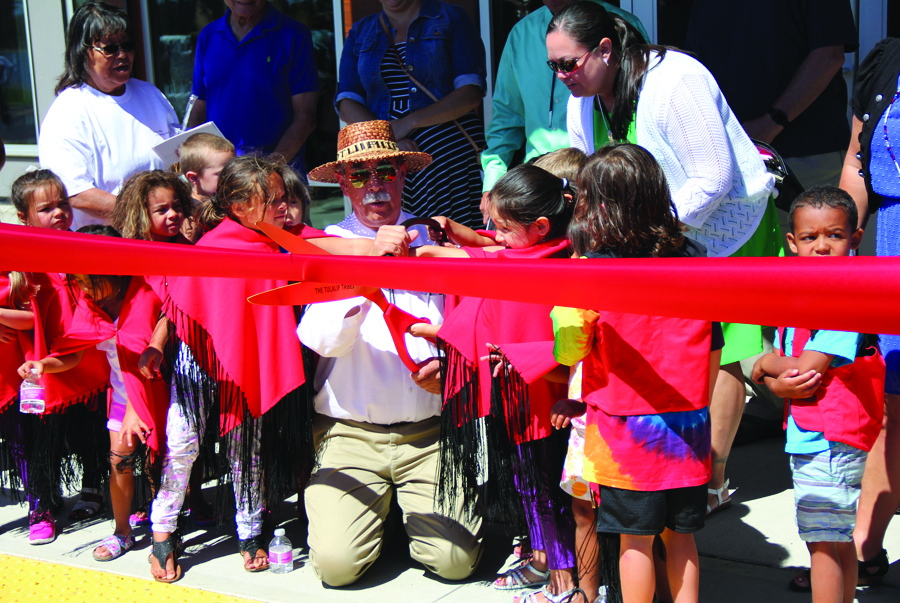 Tulalip Tribal Chairman Mel Sheldon, surrounded by 'Children of the Salmon', cuts the ribbon, officially marking the opening of the Betty J. Taylor Early Learning Academy.Photo/MIcheal Rios