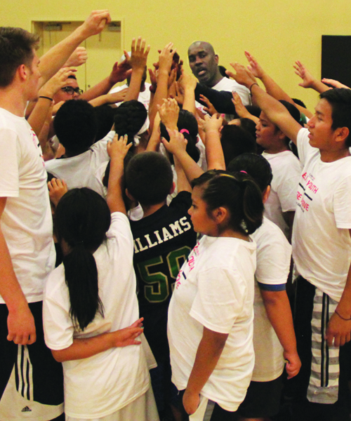 Gary Payton with Native  youth during basketball camp.Photo/Micheal Rios