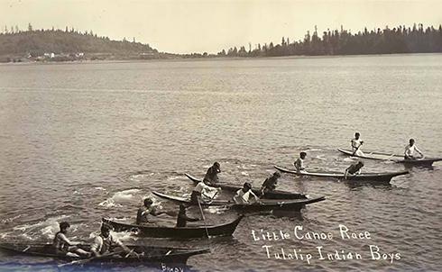 Above: Little canoe race, Tulalip Indian boys, ca. 1912. Photographer: Ferdinand Brady