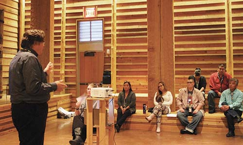 Tulalip's Chief Judge, Ron Whitener, speaks with community members at the Tulalip Hibulb Cultural Center on the benefits of the Wellness Court versus traditional court.