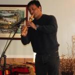 Musican Peter Ali plays contemporary native flute tunes.