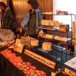 A vendor showcases beautiful wood work in Northwest Native American Coastal designs.